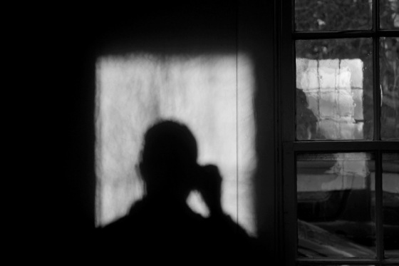 self portrait, black and white, window, reflection, shadows, light,