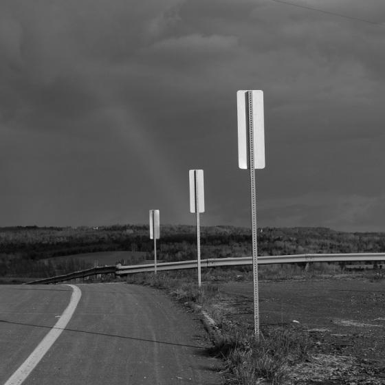 black and white, landscape, social landscape, signs, Grand-Pre, Nova Scotia, storm clouds,