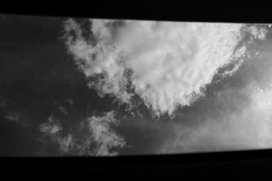 black and white, photo, window view, sunroof, sky, clouds, landscape,