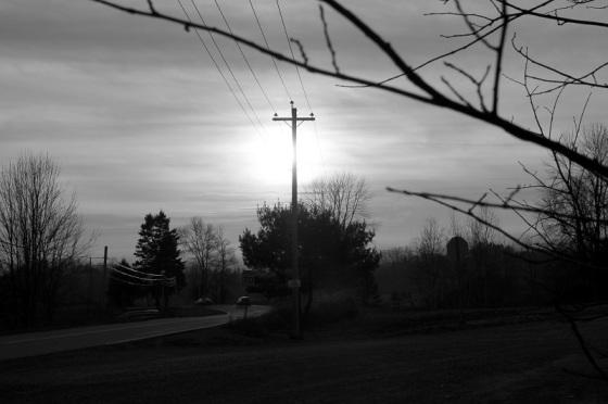 black and white, social landscape, pole, sun, silhouette,