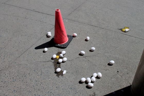 eggs, broken, caution cone, sidewalk,