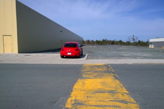 red, car, parking lot, speed bump,