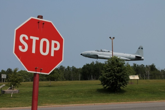 fighter jet, stop sign,