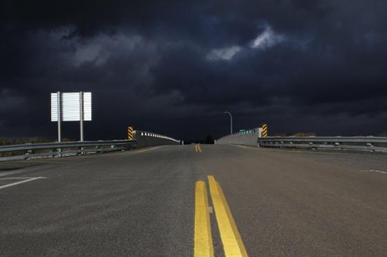 black sky, storm clouds, sunshine,