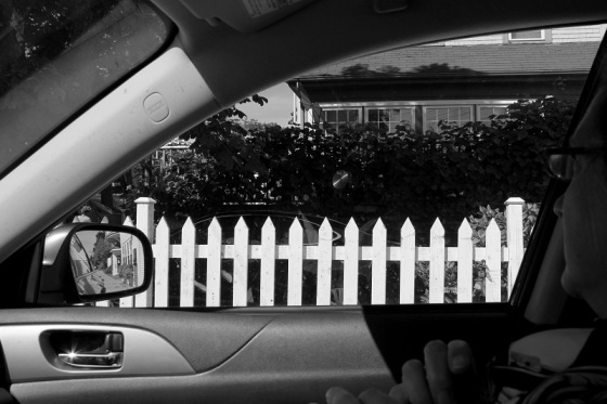 white picket fence, car, window view, side mirror,