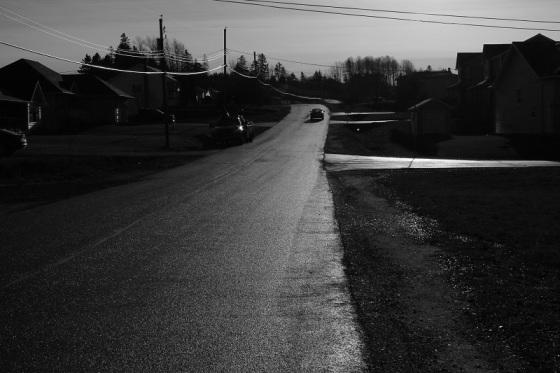 suburb, subdivision, dramatic light, car, black and white,