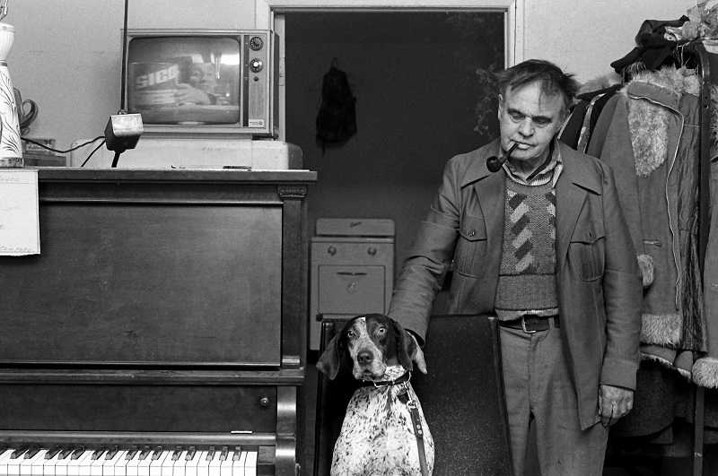 man, dog, piano, television,