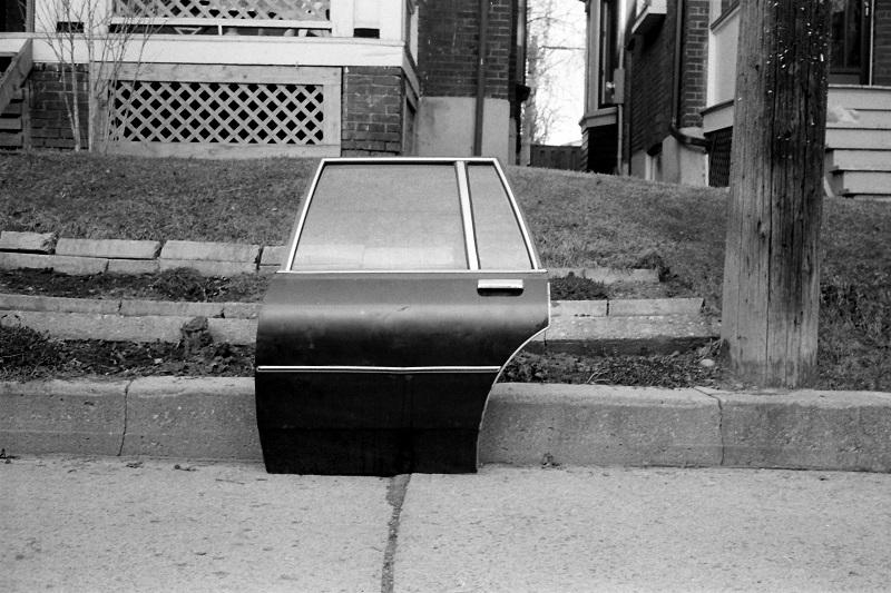 car door, sidewalk, surreal,